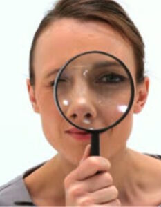 Lady with magnifying glass